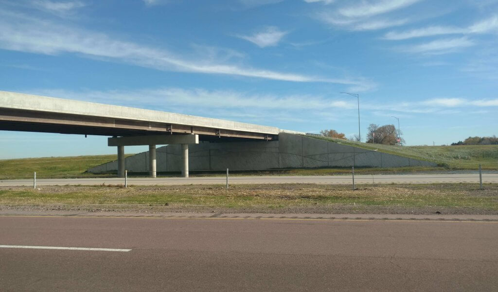 Bridge over interstate showing abutments, piers, and girders.
