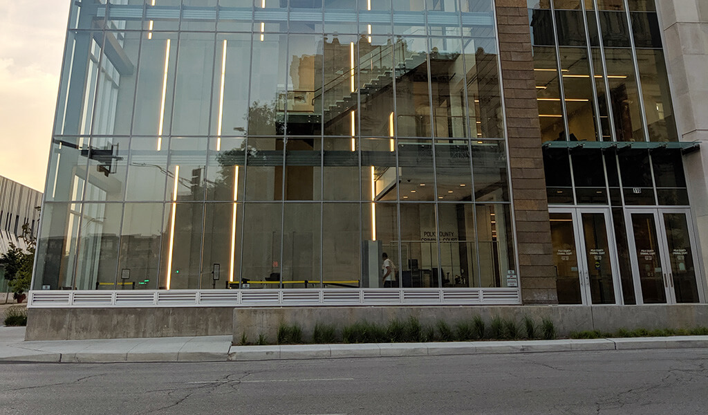 Street-level view of the open lobby and staircase in the new Polk County Criminal Court Building.
