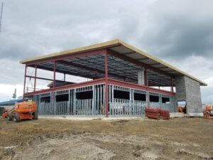 construction crews working on contemporary iDOT facility in Fairfield, IA